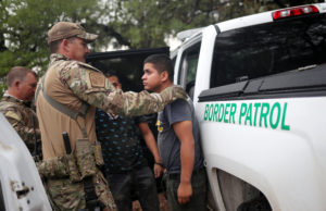 Members of the Border Patrol Search, Trauma, and Rescue Unit near Falfurrias, Texas, apprehend an immigrant from Guatemala June 19. Pope Francis told Reuters he stands with the U.S. bishops in their condemnation of the Trump administration's immigration policy has led to children being held in government shelters while their parents are detained in federal prison. (CNS photo/Adrees Latif, Reuters)